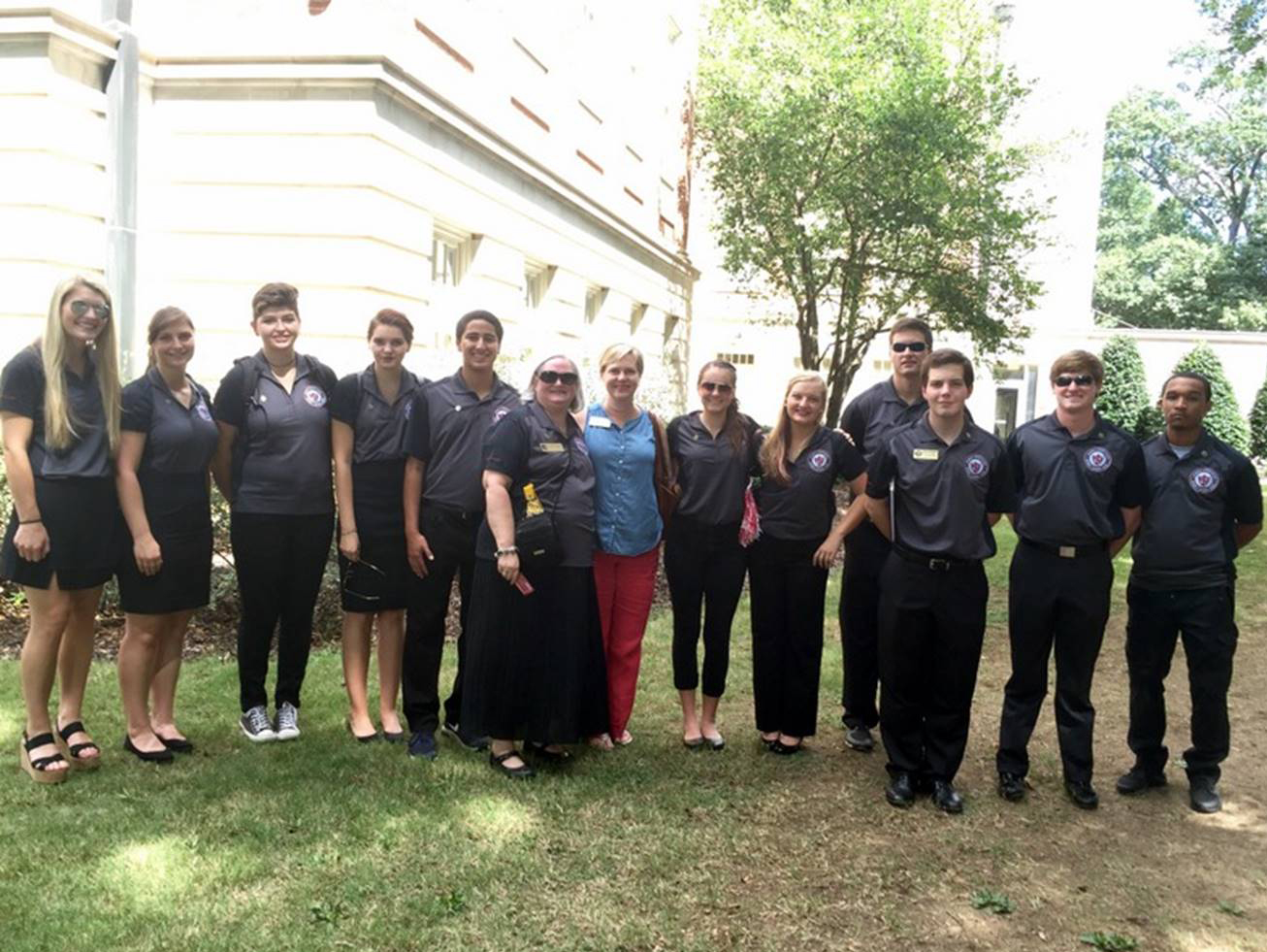 A&S Academic Honor Council justices standing with Dr. Gardiner and Dean McElroy in front of the library